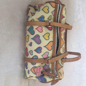 Brand new Dooney&Bourke heart print round bag